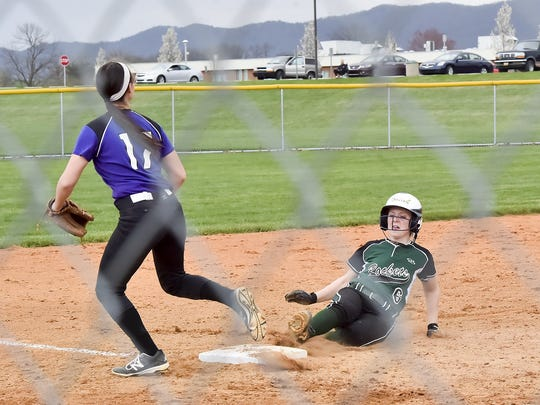 Northern York's Michaela Cotton, left, gets ready to catch a ball as Jenna Mongold slides into the base on Thursday. Against Biglerville on Friday, freshman Mongold had a fine day.