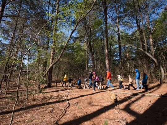 Second-graders from Benjamin Banneker Elementary School have a soil nature lesson at Abbott's Mill Nature Center.