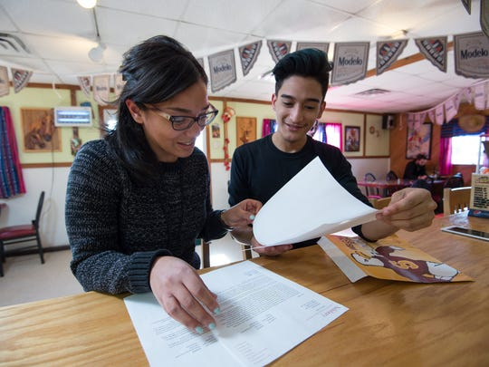 Javier Barrueta of Seaford shares his letter of acceptance to Salisbury University with Pati Candelario, a Spanish teacher at Seaford High School. Barrueta is a first-generation college-bound student.
