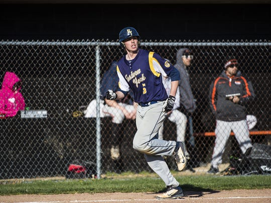 Eastern York's Colby Shimmel heads into home during