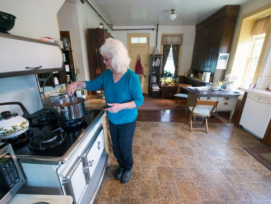 Jean Leaman cooks in the kitchen at Lady Linden Bed
