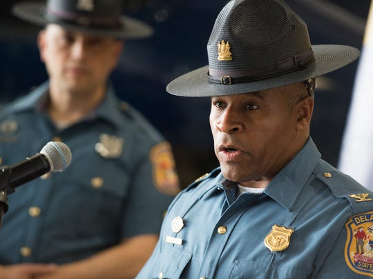 Colonel Nathaniel McQueen, Jr., speaks during a press conference by the Delaware State Police and the Delaware Department of Justice announcing the successful results of a large scale multi-agency operation that led to numerous arrests and indictments on drug, weapons and racketeering charges at the Delaware State Police aviation hanger in Georgetown.