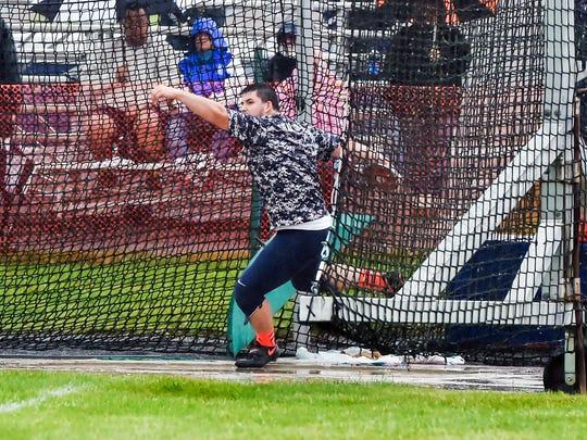 Chambersburg's Kelton Chastulik throws the discus during the P.I.A.A. District III Championship on Saturday, May 21, 2016. Chastulik took second place in AAA boys discus.