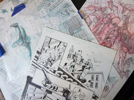 Mike Hawthorne shows some of his sketches from the 'Deadpool' comic book series.
