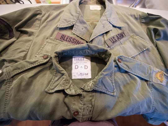 Colin Gibson's Vietnam War-era uniform shirt lies on top of  one that Tim Blessing got online to create a replica. The men met briefly as soldiers in the Vietnam War in 1967. Blessing threw out his military gear after returning.