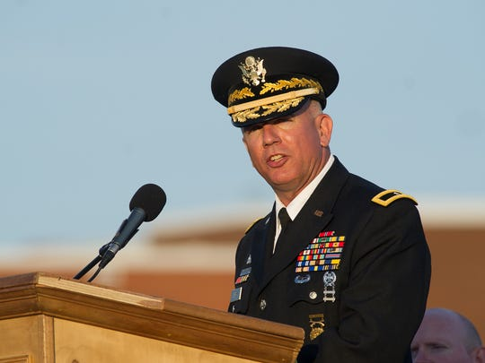 Brigadier General Michael Berry, Land Component Commander, Delaware Army National Guard, gives a speech at the Sussex Central High School graduation ceremony at Sussex Central Stadium.