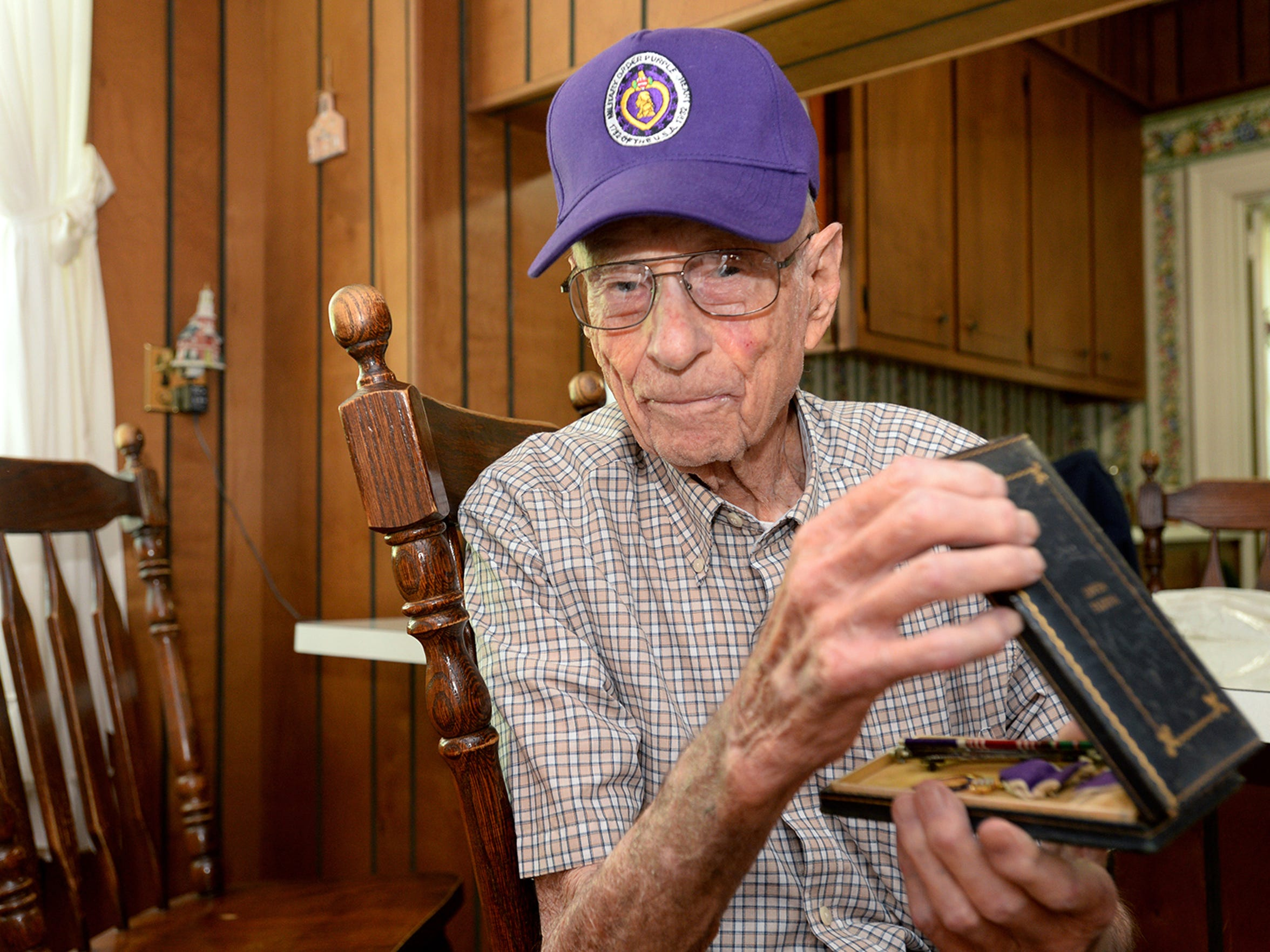 World War II veteran Paul Stegall holds a number of