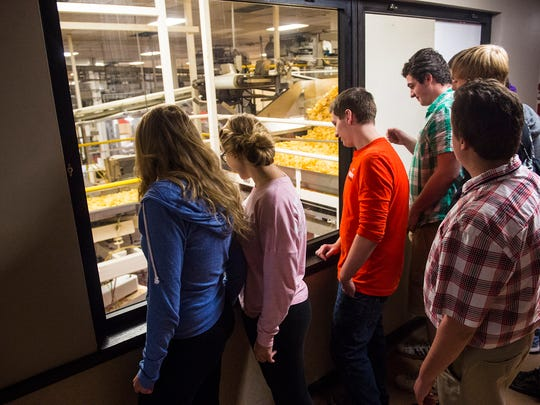Hanover High School and South Western High School students watch potato chips being made on the factory floor during a tour of the High Street Utz plant in September.