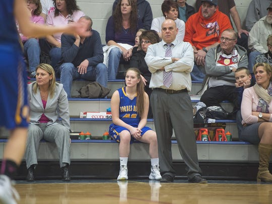 Forbes Road's Maddie Miller sits on the bench while
