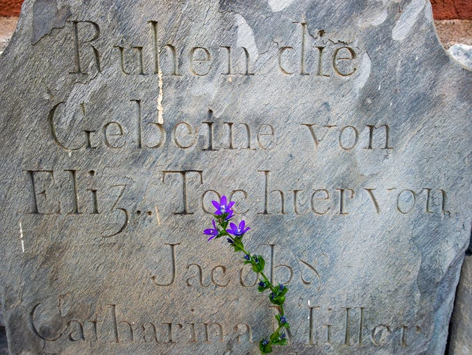 A headstone in German is at the former Zion Lutheran