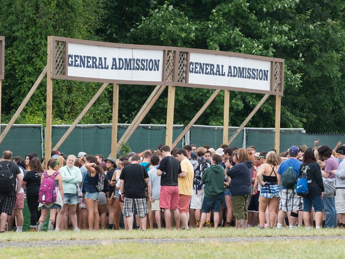 Campers line up at the entrance for the Firefly Music