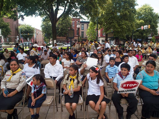 People gather to watch Greencastle Knights Pathfinder Club perform on stage after marching in downtown Chambersburg in the first Children's Rights Walk on Saturday, June 18, 2016.