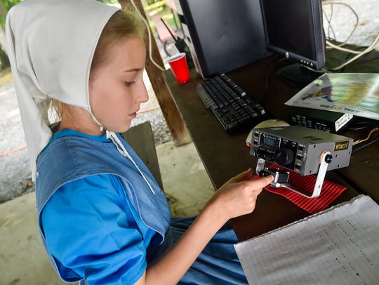 Violetta Latham, 11, practices Morse code during a