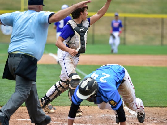 Hampden Township's James Barber (24) scores a run as Shippensburg catcher Cole Friese waits for the throw during their Region 4 American Legion tournament game on Monday.