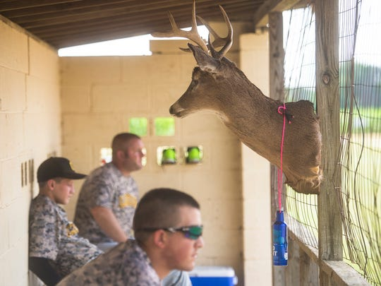 Cashtown players sit in the dugout next to the Rally Buck during the Brushtown game on July 31, 2016.