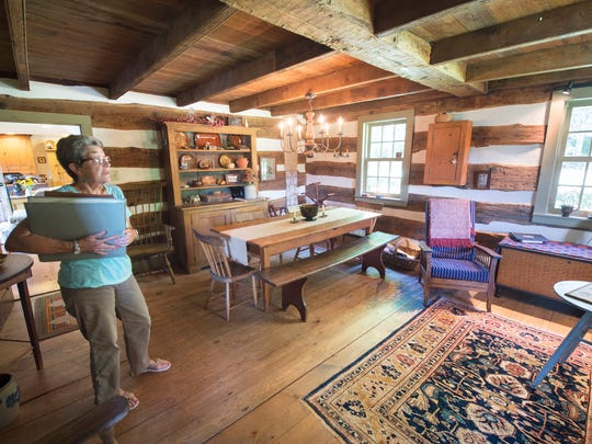 Donna Bert in the front room of her log home at Clear Spring Mills in Franklin Township.