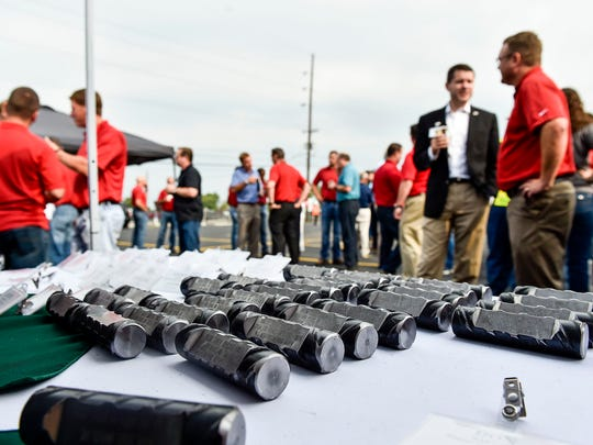 Commemorative pieces of Nucor Steel rebar lay out on a table as a memento for those attending the 100th anniversary ceremony of the Nucor Steel Plant on Friday.