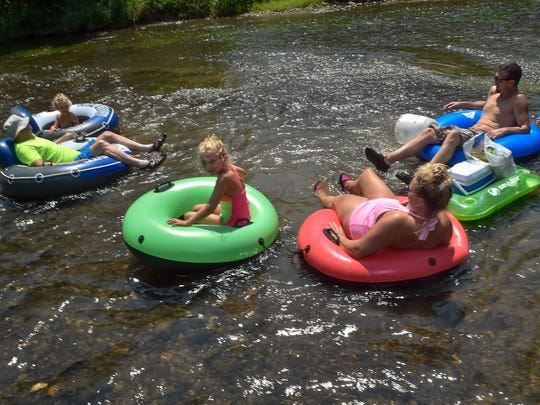 """The Brennan family get situated to float down the Conococheague Creek for """"Float the Jig for Brandi Kaye,"""" a memorial float for a late Greencastle native, during Old Home Week in Greencastle, Pa. on Saturday, August 6, 2016."""
