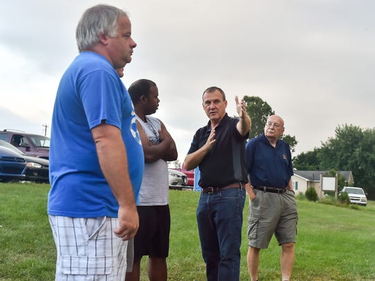 Derek Campbell explains to the soon to be officials what calls should be made during an on-field session Tuesday, August 9, 2016 in McConnellsburg, Pa. Each participant got to referee part of a soccer game to get on field experience.