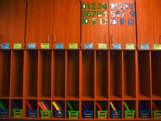 Cubby holes in Kacie Biggs' classroom at Elgin Elementary School have charts on which students write down academic goals and personal goals. Similar to the change in seating arrangements encouraging academic growth in students, words of encouragement and responsibilities in the classroom are another attempt to make the classroom an opening and nurturing environment.