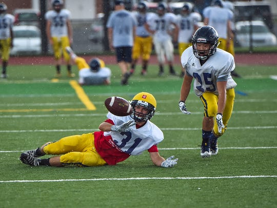 Greencastle's Kyrin Zimmerman dives to catch the football