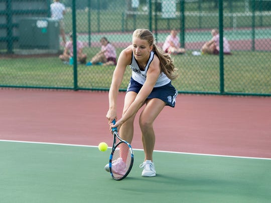 Trojan's Emma Guare goes to return the ball during a tennis match against State College at Norlo Park in Fayetteville, Pa. on Wednesday, August 24, 2016