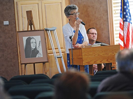 Mary Rose speaks during a memorial service for Sharon Hensley Tuesday, Aug. 30, 2016, in Bismarck, N.D. Hensley went missing in 1973. Felix Vail, who was recently found guilty in the 1962 murder of his first wife, Mary Horton Vail, was the last known person with Sharon Hensley and Mary Rose's daughter, Annette Craver Vail.