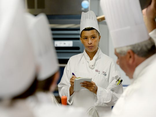 Culinary Institute of the Carolinas student Cat Gbedey, center, takes notes as Chef Michael Granata, right, teaches Principles of Food Production I at the Greenville Technical College Northwest campus on Wednesday.