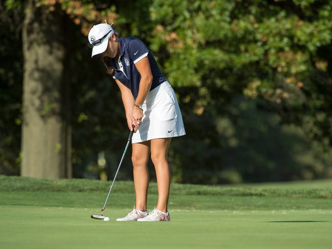 Trojan's Mary Kate Norcross putts the ball during a