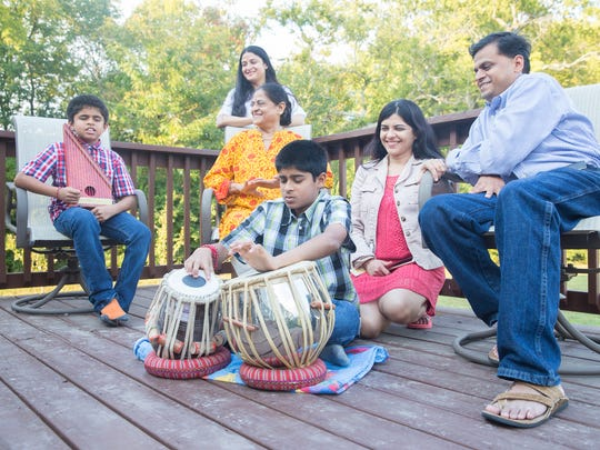 From left, Sankalp Shibad, Supriya Bhagwat, Dr. Shaila Shibad, Sanskrit Shibad, Sahana Shibad and Salil Shibad sing and play music on their patio in Brentwood. Dr. Shibad retired from practicing medicine and moved from India to live with her son, Salil, his wife, Sahana, and their two children in Brentwood.
