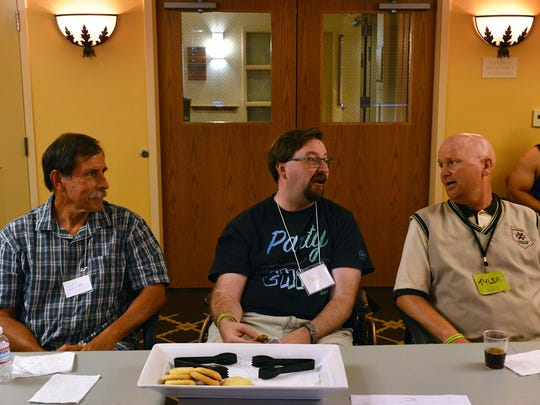 Jim Cota, from left, Paul Agge and Tyler Sutton share their experiences during a Brain Injury Center of Ventura County support group meeting in Camarillo. Agge's caregiver, Sergio Zarco, sits in the background. The center offers services for people with brain injury and their loved ones.