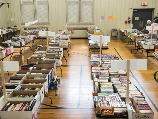 Tables of books fill the gym at the Colonial Day Book