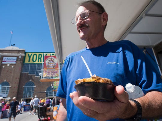 Jim Mundy, of York, with a baked potato from York Jaycees