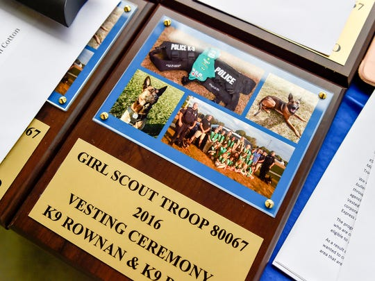 Each girl in Chambersburg Troop 80067 received a plaque during a ceremony honoring them for fundraising money to get the K-9 unit bullet proof vest. There are 19 girls in the troop.