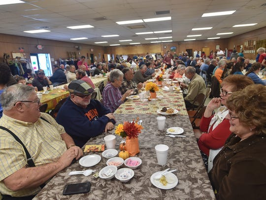 People enjoyed community suppers, such as this 2015 Thanksgiving meal, at the Lemasters Community Center. The association has liquidated and donated its assets. The local family who hosted the annual Thanksgiving meals rented the venue each year.