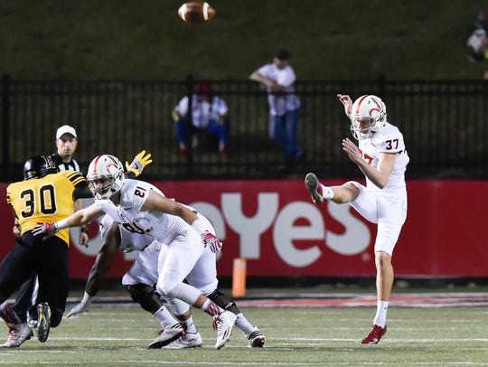 Steven Coutts punts the ball as the Cajuns take on
