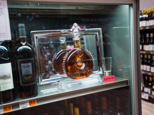 At $3,000, this bottle of Louis XIII Cognac is among the most expensive items sold at Champagne's.