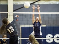 Shalom Christian's Lauren Stains (18) goes up for a block earlier this season. Stains had 17 kills and 12 digs on Friday night to help lead the Flames to the Mason-Dixon Christian Conference championships.