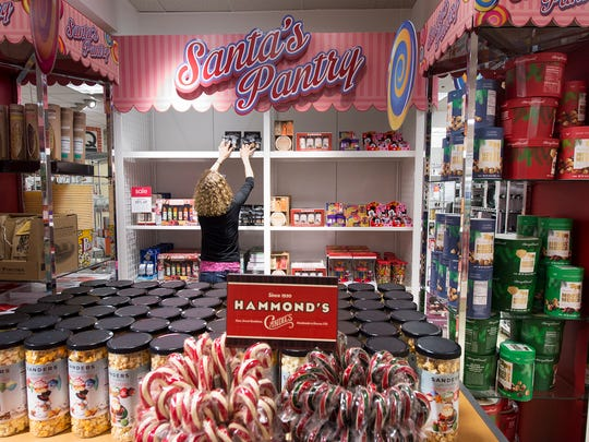 Jill Redmond, a visual coordinator at the Bon-Ton store in York Galleria, arranges the store's Santa's Pantry. The section of the store features Christmas-themed items.