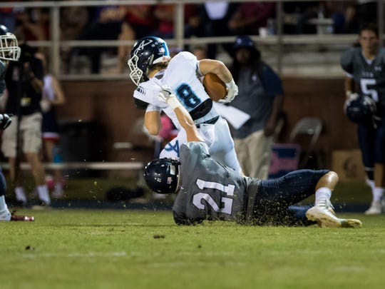 Colton Williams drags down Seth Kersteter as Lafayette Christian Academy host the Ascension Blue Gators. October 28, 2016.
