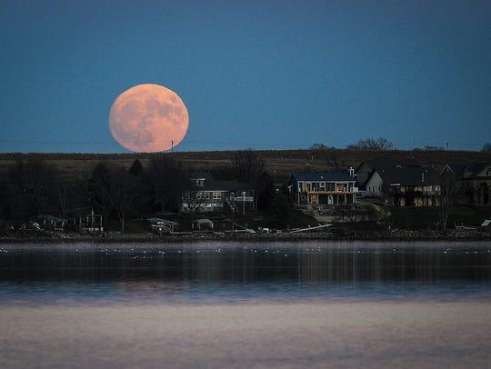 the super moon rises over Brant Lake Sunday, Nov. 13,