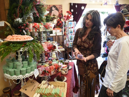Jodi Bowlin, left, helps customer Carla Cox with a purchase at Knoxville Soap & Candle in 2016.