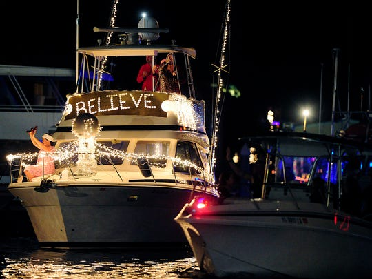 The vessel The Back Side passes Saturday, Dec. 8, 2012, on Naples Bay. Hundreds lined the shore to watch the annual Naples Holiday Boat Parade. Water vessels were decked out in festive holiday lights and judged at the Naples Boating and Yacht Club for competition. Frank Perrucci, president of the Marine Industries Associations of Collier County, Inc. emceed the event. Judging included Mayor John Sorey, among others. A total of 30 boats competed.