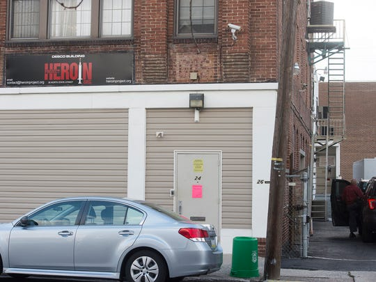 Several county detectives were seen entering and exiting this building, which sits at 20-26 N. State St., on Monday.