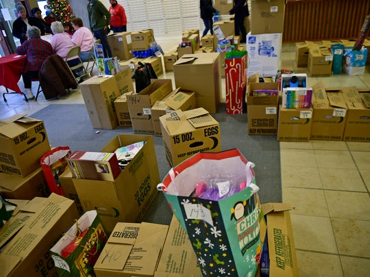 The floor is filled with boxes of gifts during the Salvation Army Angle Tree event at Chambersburg Mall, Thursday, December 15, 2016.