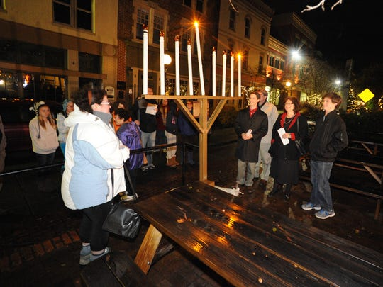 Members of the Beth Israel Congregation and the Salisbury community celebrate the lighting of the menorah downtown for the first night of Hanukkah.