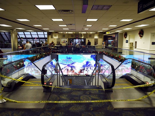 Patrick Dove, Treasure Coast Newspapers Yellow caution tape blocks an entrance to the baggage claim area in Terminal 2 of the Fort Lauderdale-Hollywood International Airport, two days after a gunman killed five people and injured six in early January.