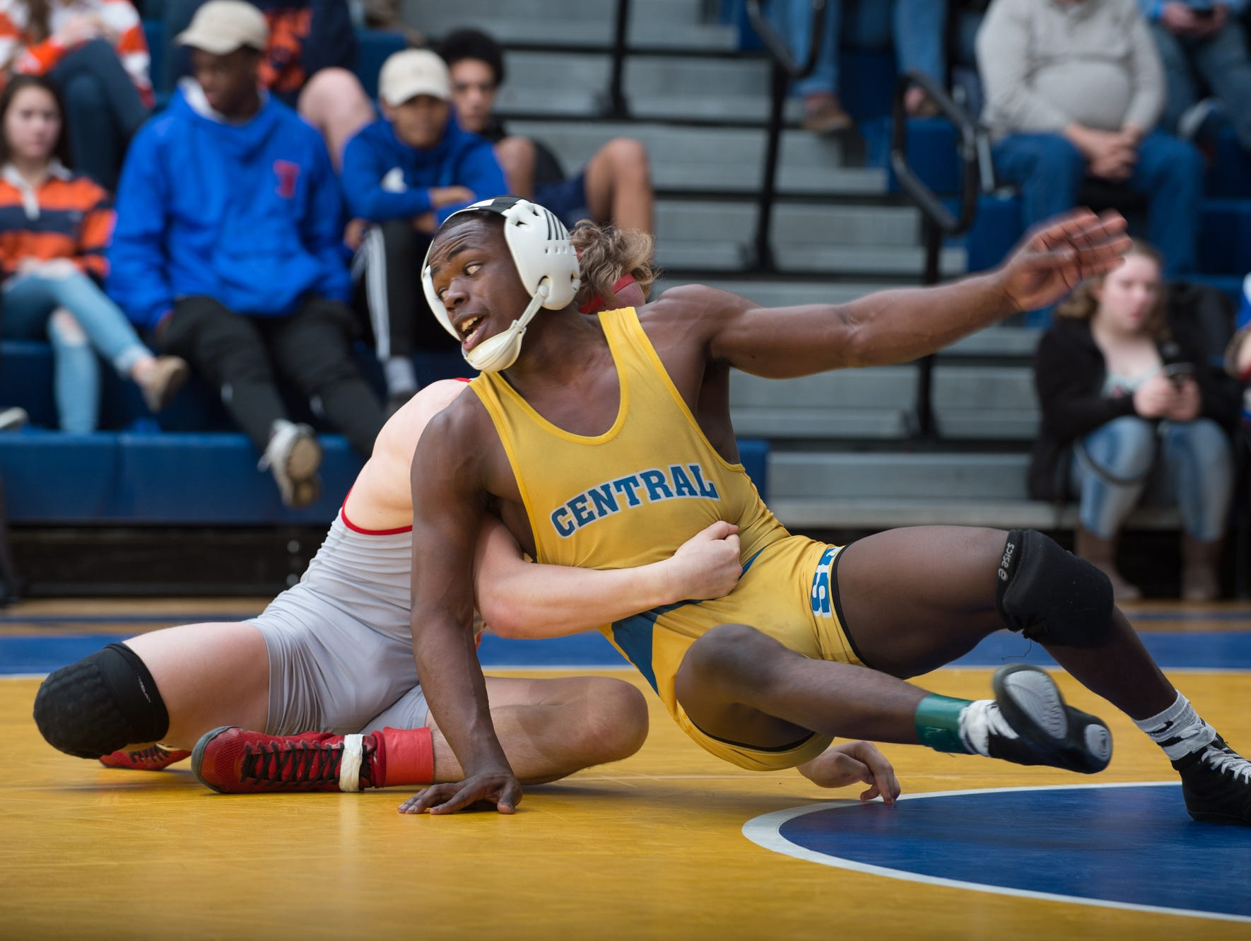 Sussex Central's Rashad Stratton works to get away from a hold by Smyrna's Cole Sebastianelli in the 126 pound championship match at the Henlopen Conference wrestling tournament at Sussex Central High School.