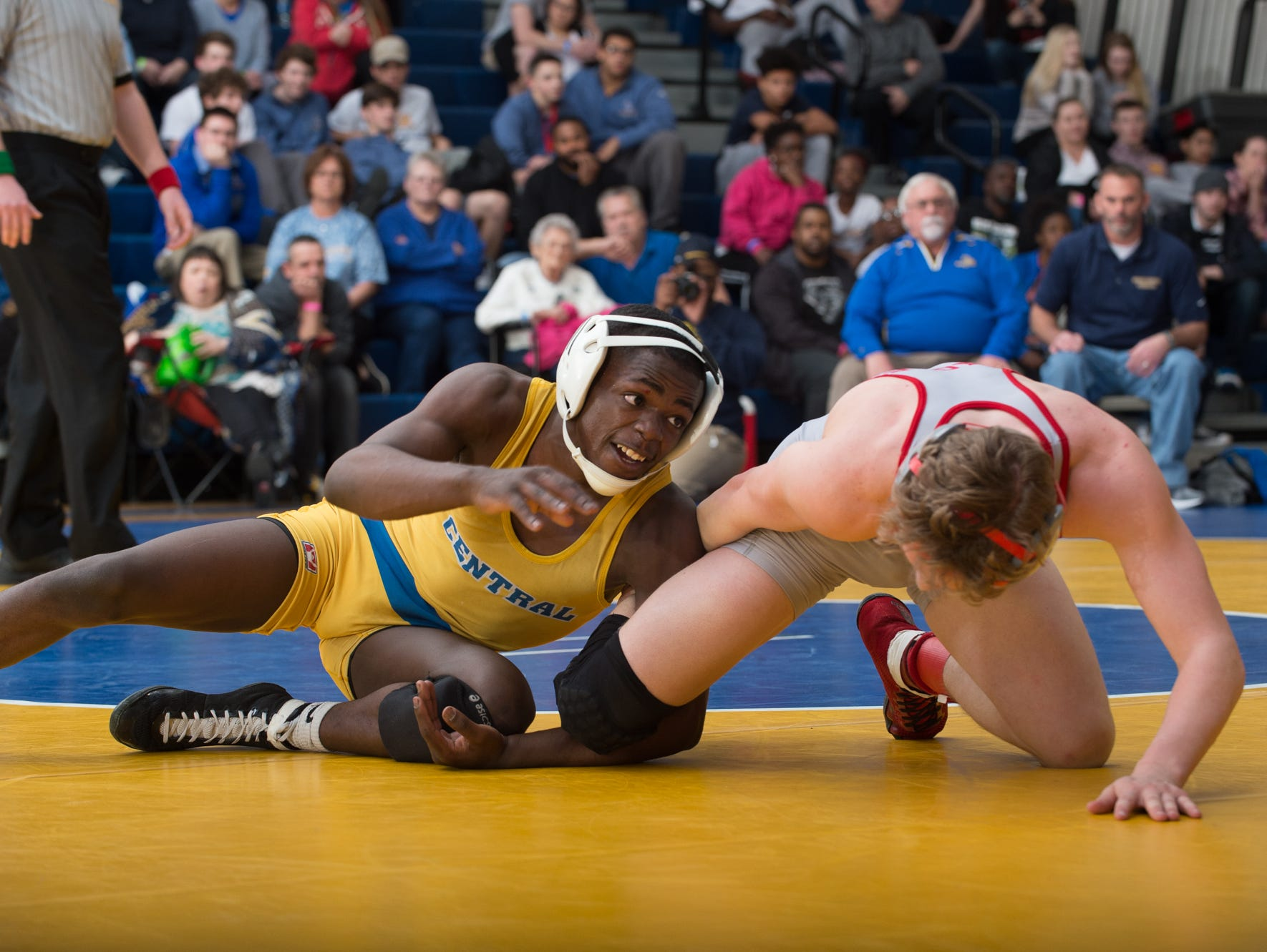 Sussex Central's Rashad Stratton, left, wrestles Smyrna's Cole Sebastianelli in the 126 pound championship match at the Henlopen Conference wrestling tournament at Sussex Central High School.