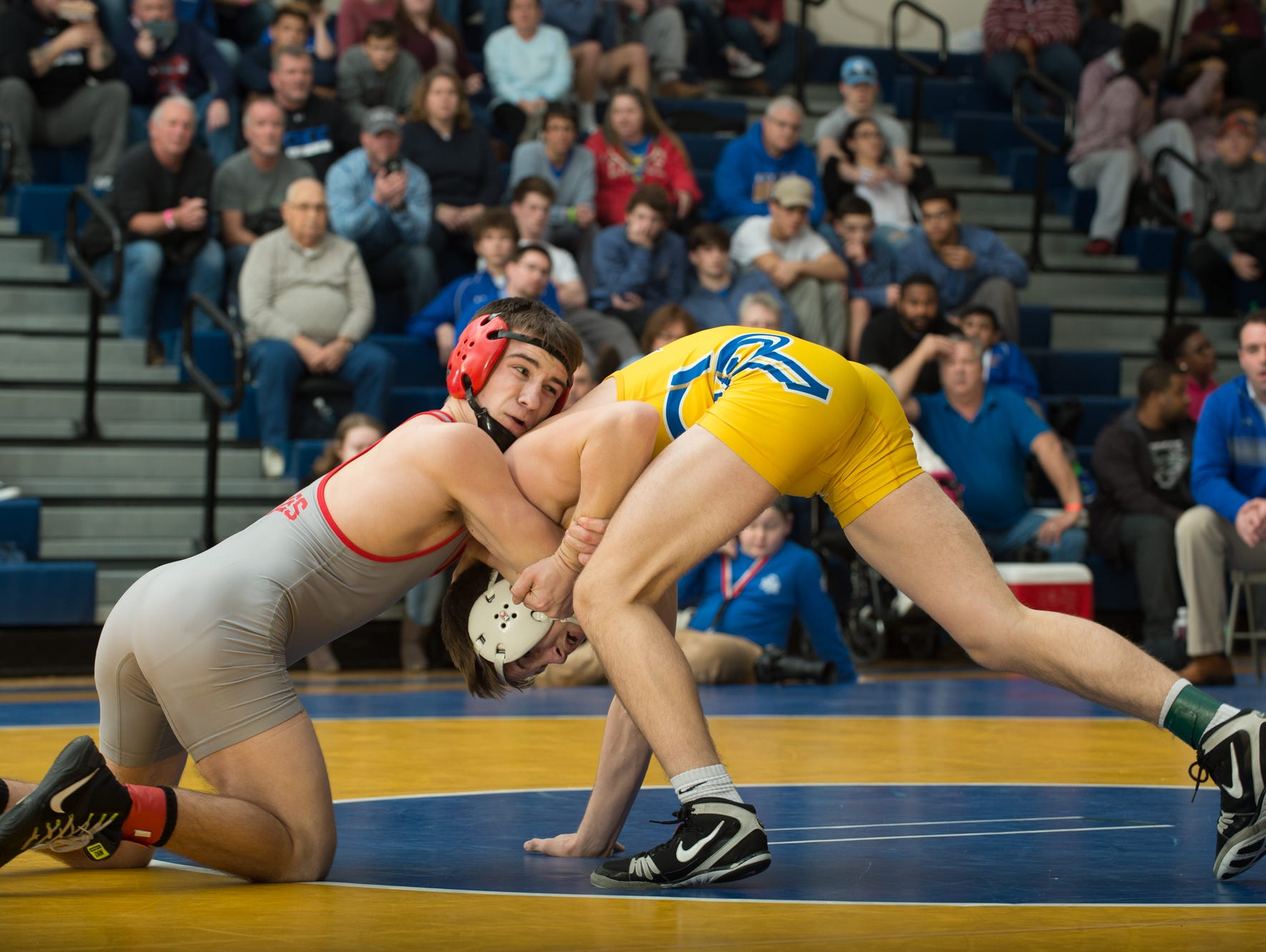 Action shots from the finals of the Henlopen Conference wrestling tournament. Presto ID 97919668